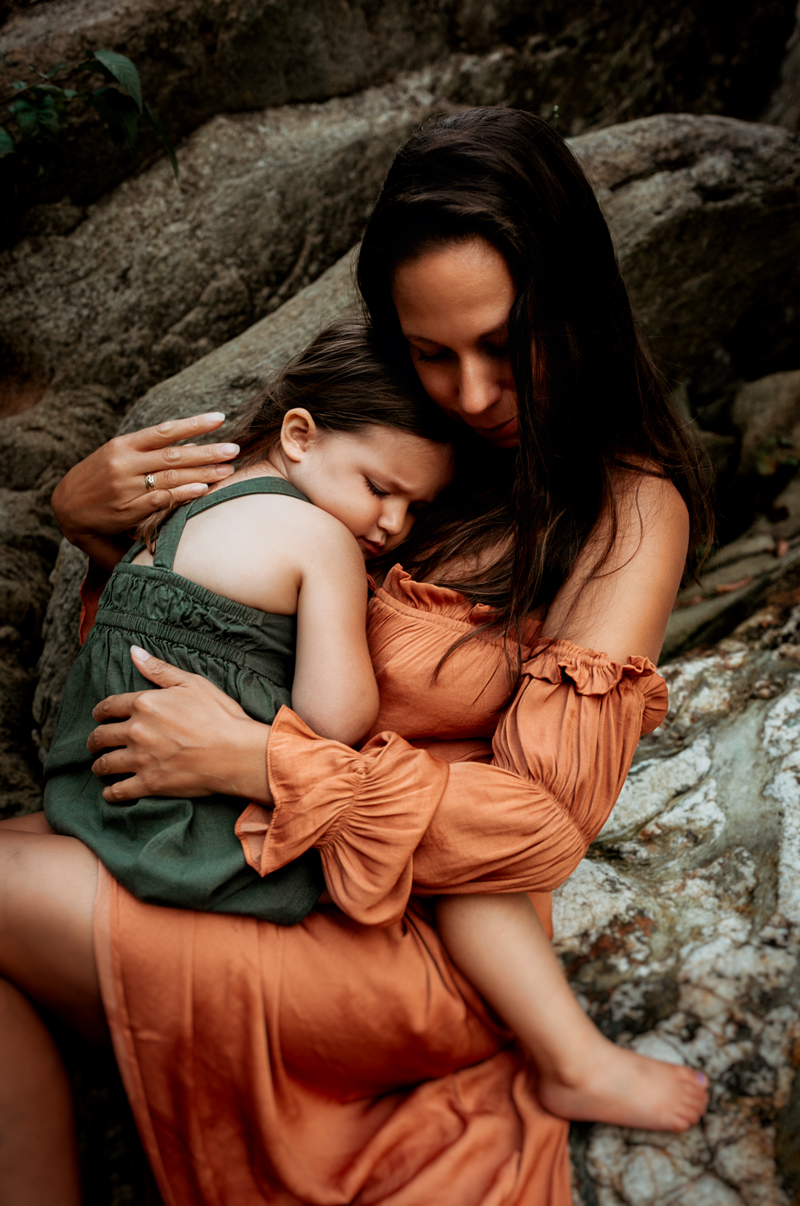 """""""Colorful photograph of mother holding daughter by Megan Marie Photographer."""""""