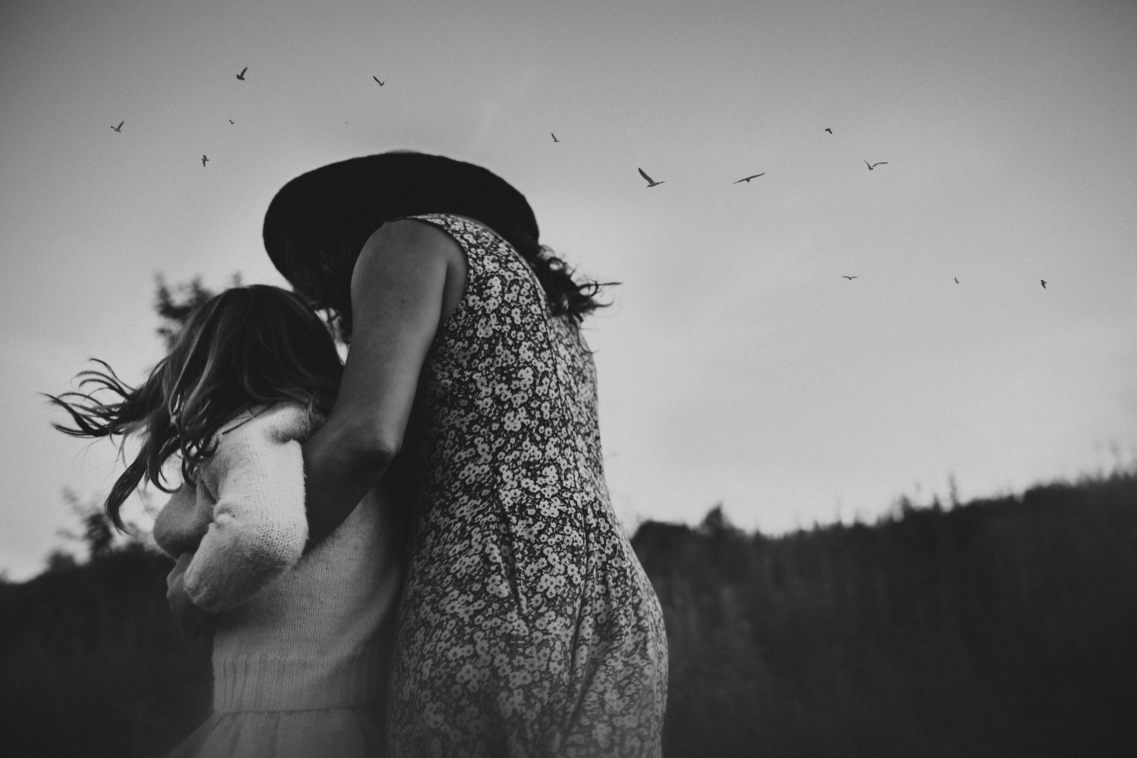 """""""Black and white mother and child photograph with birds by Megan Marie Photographer."""""""